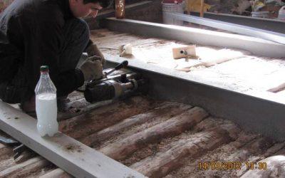 Перфорация балки перекрытия для усиления швеллером на болтах.